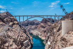 Picturesque Colorado River and the arch bridge. Tourist attraction of Nevada and Arizona, USA. The Hoover Dam and the arch bridge over the Colorado River Stock Images
