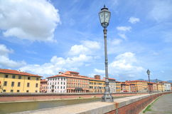 Picturesque colorful historic buildings along Arno river in Pisa, Italy Stock Images