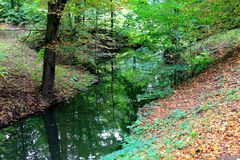 Picturesque corner of autumn park. With a small river stock image