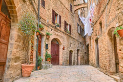 Picturesque corner in Volterra, Tuscany, Italy. A picturesque typical corner with clothes hanging in the old town of Volterra, Tuscany, Italy Royalty Free Stock Image