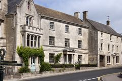 Picturesque Cotswolds - Painswick. Picturesque Cotswold stone houses on the main street through Painswick, Gloucestershire, UK royalty free stock photos