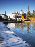 Picturesque Cottage at Mountain Lake Royalty Free Stock Image