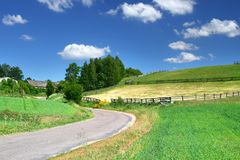 Picturesque country road and fields Stock Images