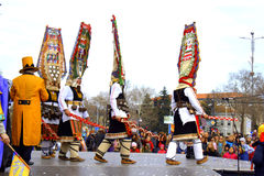 Picturesque dancing mummers Carnival scene Stock Photo