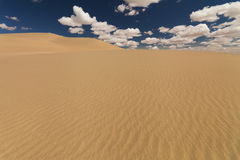 Picturesque desert landscape on the background of blue sky Stock Images