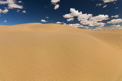 Picturesque desert landscape on the background of blue sky Royalty Free Stock Photo