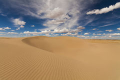 Picturesque desert landscape on the background of blue sky Royalty Free Stock Image
