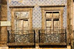 Picturesque dilapidated balconies.Porto. Portugal. Dilapidated balcony and building in Carlos  Alberto square. Porto. Portugal Stock Photo