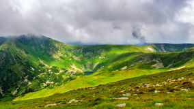 Picturesque and dramatic Carpathian mountains under huge rain clouds, nature landscape in summer, Ukraine. Royalty Free Stock Photography