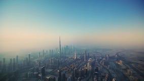 Picturesque drone aerial flight over futuristic skyscraper towers of Dubai downtown in morning fog sunrise. Picturesque drone aerial flight over futuristic stock video
