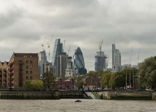 Picturesque East London buildings and skyscrapers viewed from the Thames river Royalty Free Stock Image