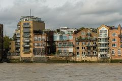 Picturesque East London buildings viewed from the Thames river Stock Photos