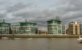 Picturesque East London buildings viewed from the Thames river Stock Photography