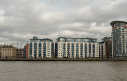 Picturesque East London buildings viewed from the Thames river Royalty Free Stock Photos