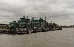 Picturesque East London buildings viewed from the Thames river Stock Image