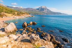 Picturesque empty beach of a bay surrounded. By mountains royalty free stock photo