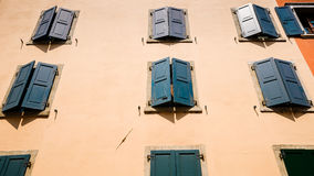 Picturesque facede,shutters and alleys in northern italy, near l Royalty Free Stock Photo