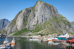 Picturesque fishing town of Reine by the fjord on Lofoten island Royalty Free Stock Images