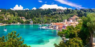 Picturesque fishing village Lakka in Paxos with turquoise sea, I Stock Photos