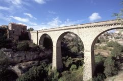 Picturesque France - Minerve. France, Languedoc-Roussillon, Herault, road bridge over the dried up river bed that encircles Minerve, a fortified Cathar village stock images