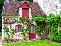 A picturesque French cottage in the village France Royalty Free Stock Image