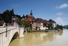 Picturesque German town upon a brown river. Picturesque German town upon a river with a bridge Stock Images