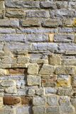 Picturesque Gloucestershire - Tewkesbury. Stone and brick texture on an old worn and repaired wall, Tewkesbury, Gloucestershire, Severn Vale, UK Stock Photo