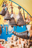 Picturesque goods at a fair:  horn of plenty and hand bells from birch bark Royalty Free Stock Photo