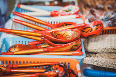 Picturesque goods at a fair: wooden painted spoons stock images