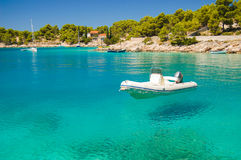 Picturesque gorgeous view of motorboat in a quiet bay of Milna on Brac island, Croatia. Picturesque gorgeous view of motorboat in a quiet bay of Milna on Brac stock images