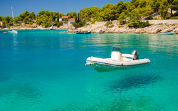 Picturesque gorgeous view of motorboat in a quiet bay of Milna on Brac island, Croatia. Picturesque gorgeous view of motorboat in a quiet bay of Milna on Brac royalty free stock photo