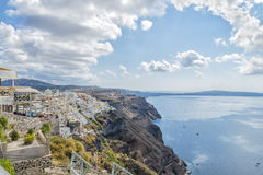 Picturesque greek houses and romantic panoramic view on Fira town and caldera. Beautiful natural landscape. Santorini. Royalty Free Stock Photos