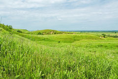 Picturesque green hills on a cloudy summer day Royalty Free Stock Photo
