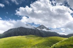 Picturesque Green Hills, Meadow And Mountains In The Clouds. Elbrus, North Caucasus, Russia Stock Images
