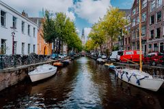 Picturesque Groenburgwal canal in Amsterdam with the Soutern church Zuiderkerk at sunset in early autumn royalty free stock photo