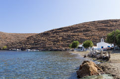 Picturesque gulf with a small white church in Kythnos island, Cyclades, Greece Stock Image