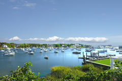 Picturesque harbor. Scenic view of boats moored in picturesque harbor, New England area, U.S.A Royalty Free Stock Photography