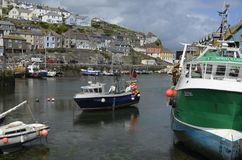 Mevagissey Harbour near St. Austell in Cornwall. The Picturesque Harbour of the Quaint Town of Mevagissey near St. Austell in Cornwall Stock Photo
