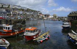Mevagissey Harbour near St. Austell in Cornwall. The Picturesque Harbour of the Quaint Town of Mevagissey near St. Austell in Cornwall Stock Images