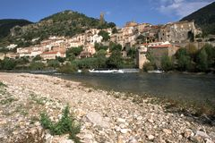 France, Herault, Roquebrun. Picturesque hillside village by the River Orb, Roquebrun, Herault 34, Languedoc-Roussillon, France stock photography