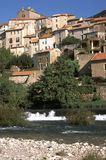 France, Herault, Roquebrun. The picturesque hillside village of Roquebrun by the River Orb, Herault, Languedoc-Roussillon, France stock images