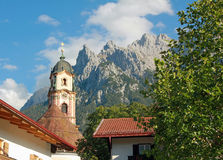 Picturesque historic church and karwendel alps, mittenwald Stock Photo