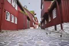 Typical old red-painted houses on Tinganes in the old town of Tórshavn of the Faroe Islands. stock photography