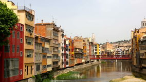 Picturesque homes on  river bank in Girona. Day view of river and picturesque homes in Girona stock footage