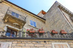 Picturesque house with flowers on balcony in the Italian city Stock Photo