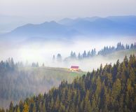 Picturesque house in the fog Royalty Free Stock Photo