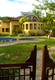 Picturesque house garden pool gates Stock Photo