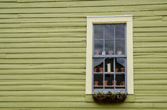 Picturesque house with window and flowerpots Royalty Free Stock Photography