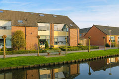 Picturesque houses on the canal in Meerkerk, Netherlands Stock Photography