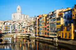 Picturesque houses and church on river Onyar  in Gerona Stock Image